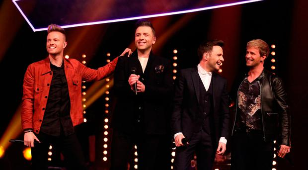 Westlife fans go into a frenzy as group announce new album's September release