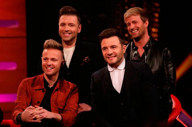 Westlife, ((back row) Kian Egan, Markus Feehily, (front row) Nicky Byrne and Shane Filan) during the filming for the Graham Norton Show=
