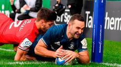 Dave Kearney of Leinster scores his side's second try despite the tackle of Romain Ntamack of Toulouse during the Heineken Champions Cup Pool 1 Round 5 match between Leinster and Toulouse at the RDS Arena in Dublin. Photo by Stephen McCarthy/Sportsfile