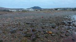 Recent stormy weather has once again stripped the sandy garments from the beach in Achill. Photo: Sean Molloy