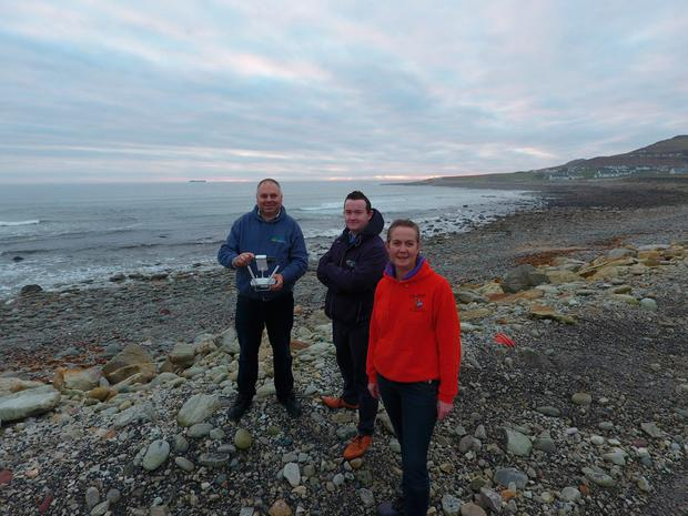 Sean Molloy (left) and his wife Etain O'Connor alongside Emmet Callaghan of Achill Tourism (centre)