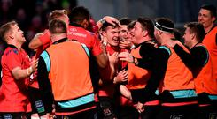Jacob Stockdale of Ulster, centre, celebrates with team-mates after scoring his side's third try during the Heineken Champions Cup Pool 4 Round 5 match between Ulster and Racing 92 at the Kingspan Stadium in Belfast, Co. Antrim. Photo by Oliver McVeigh/Sportsfile