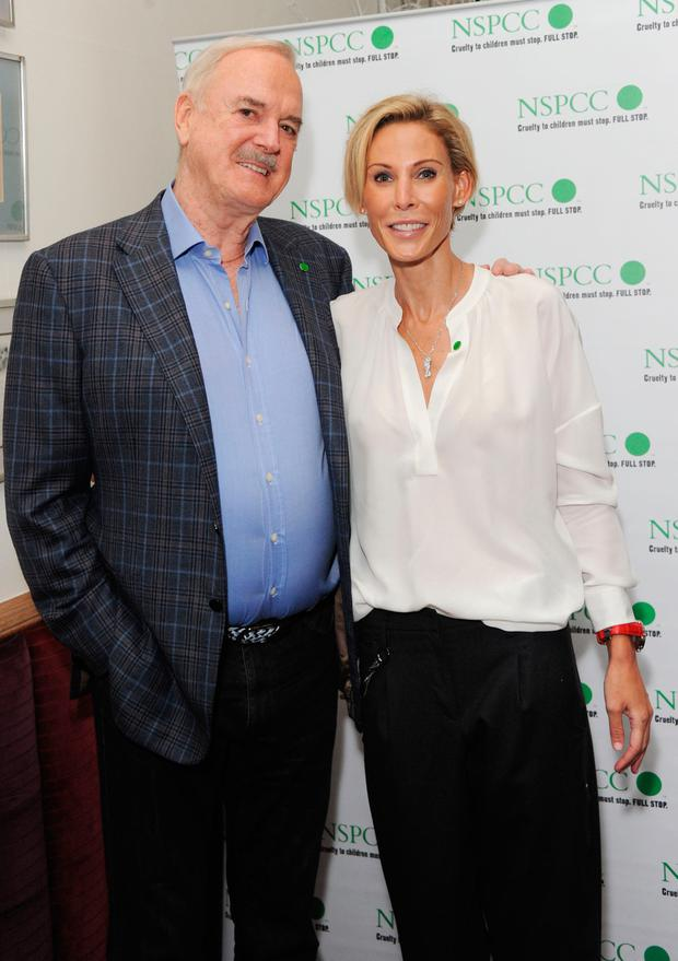 AGE GAP: John Cleese with partner Jennifer Wade, who is 31 years younger. Picture: Getty