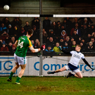 Michael Newman of Meath blazes the ball over the bar. Photo by Sam Barnes/Sportsfile