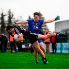 Pat Hughes of Sligo takes a tumble under pressure from Roscommon's Garry Patterson. Photo by David Fitzgerald/Sportsfile