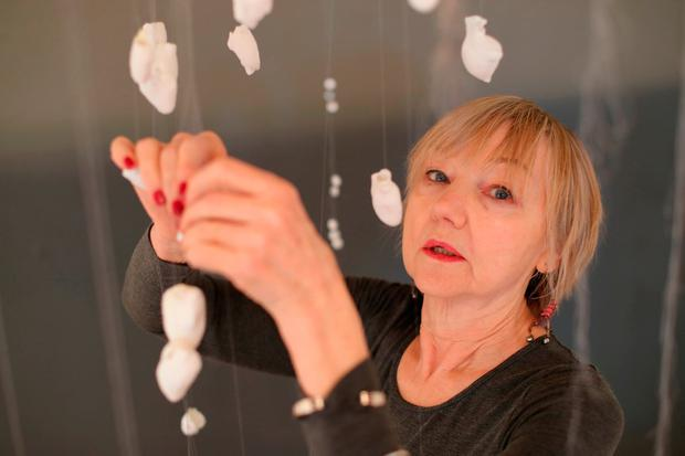 Artist Bonnie Kavanagh with her china heart installation in memory of the Tuam babies. Photo: Niall Carson/PA Wire