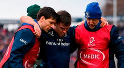 Luke McGrath leaves the pitch after picking up an injury. Photo: Stephen McCarthy/Sportsfile