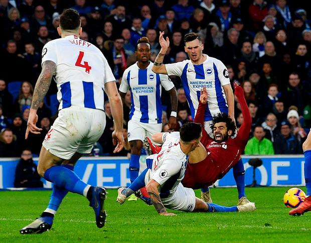Spot on: Mo Salah hits the deck after being fouled by Brighton's Pascal Grob. Photo: John Powell/Liverpool FC via Getty Images