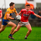 Gary Brennan of Clare in action against Mark Collins of Cork. Photo by Diarmuid Greene/Sportsfile
