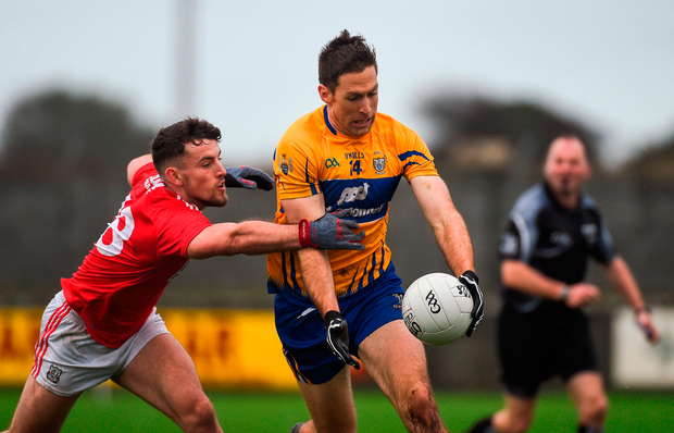 Gary Brennan of Clare in action against Nathan Walsh of Cork. Photo by Diarmuid Greene/Sportsfile