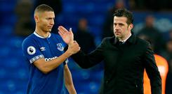 Everton's Richarlison shakes hands with manager Marco Silva at the end of the match. Photo: Andrew Yates/Reuters