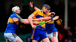 Clare's Colin Guilfoyle battling Ronan Maher and Pádraic Maher of Tipperary during yesterday's Co-Op Superstores Munster Hurling League final at the Gaelic Grounds. Photo by Piaras Ó Mídheach/Sportsfile