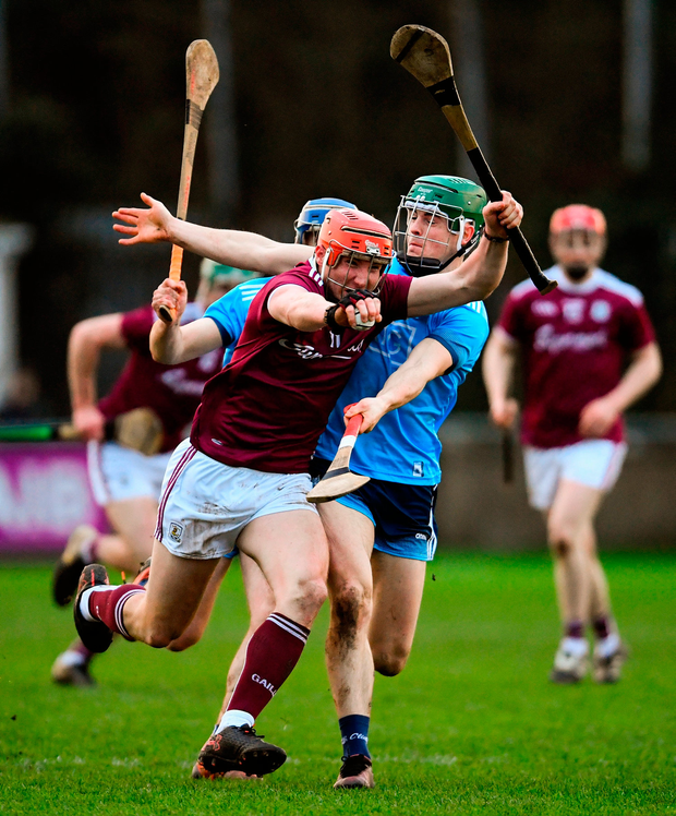 Conor Whelan of Galway is tackled by Tómas Connolly of Dublin. Photo by Ramsey Cardy/Sportsfile