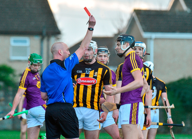 Referee John Keenan shows a red card to Jack O'Connor of Wexford and Liam Blanchfield of Kilkenny. Photo by Matt Browne/Sportsfile