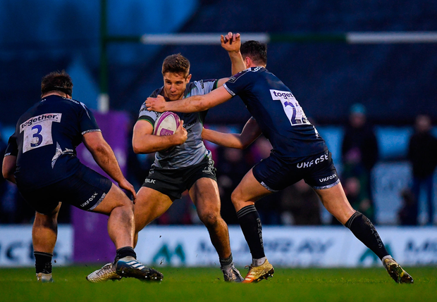 Kyle Godwin of Connacht is tackled by Luke James, right, and Will Griff John of Sale Sharks. Photo by Harry Murphy/Sportsfile