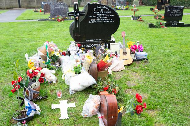 Delores O'Riordan's grave at Caherelly, which fans have turned into a shrine for the singer