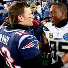 Los Angeles Chargers tight end Antonio Gates (85) and New England Patriots quarterback Tom Brady (12) embrace after an AFC Divisional playoff football game at Gillette Stadium. Photo: Greg M. Cooper-USA TODAY Sports