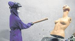 Bat: A female customer smashes a mannequin in the anger room in Beijing. Photo: REUTERS/Jason Lee