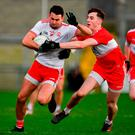 Kyle Coney of Tyrone in action against Conor Mullholland of Derry during the Bank of Ireland Dr McKenna Cup semi-final match between Tyrone and Derry at the Athletic Grounds in Armagh. Photo by Sam Barnes/Sportsfile