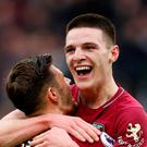 West Ham's Declan Rice celebrates after the Arsenal match with Aaron Cresswell. REUTERS/David Klein
