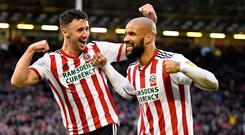 David McGoldrick of Sheffield United celebrates with Enda Stevens after scoring the opening goal during the Sky Bet Championship match between Sheffield United and Queens Park Rangers at Bramall Lane on Saturday. (Photo by George Wood/Getty Images)
