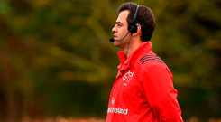 Johann van Graan is wired up as he oversees yesterday's training session. Photo: Sportsfile