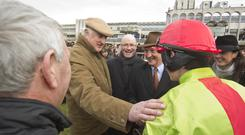 Noel Hayes (centre), of the Man About Town Syndicate, congratulates Bryan Cooper after his win aboard Our Conor in the Juvenile Hurdle at Leopardstown in 2013. Photo: Patrick McCann