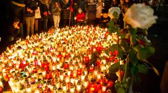 Grief: People place candles as they mourn the mayor of Gdansk, Pawel Adamowicz in Gdansk, Poland.