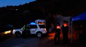 Emergency team members look for a boy fell into the 100-meter-deep waterhole in a mountainous area near the town of Totalan in Malaga, Spain, yesterday. Photo: AP Photo/Gregorio Marrero