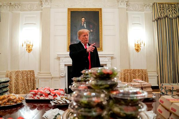 U.S. President Donald Trump speaks in front of fast food provided for the 2018 College Football Playoff National Champion Clemson Tigers due to the partial government shutdown in the State Dining Room of the White House in Washington, U.S., January 14, 2019. REUTERS/Joshua Roberts