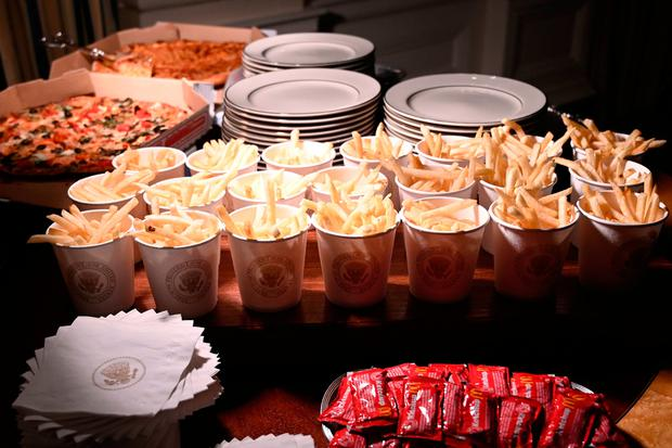 French fries and pizza are some of the fast food items for the reception for the Clemson Tigers in the State Dining Room of the White House in Washington, Monday, Jan. 14, 2019. (AP Photo/Susan Walsh)