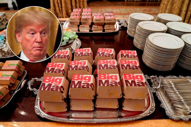 U.S. President Donald Trump pictured with the fast food provided for the 2018 College Football Playoff National Champion Clemson Tigers due to the partial government shutdown REUTERS/Joshua Roberts
