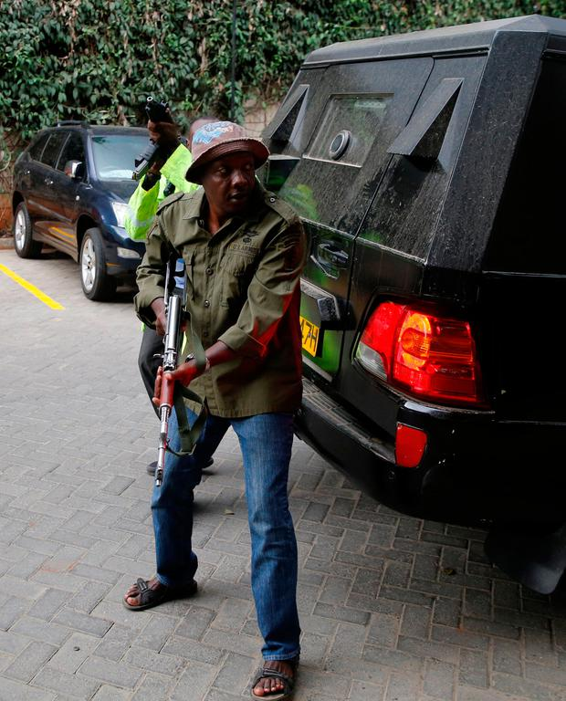 A member of security forces is seen at the scene where explosions and gunshots were heard at the Dusit hotel compound, in Nairobi, Kenya January 15, 2019. REUTERS/Thomas Mukoya