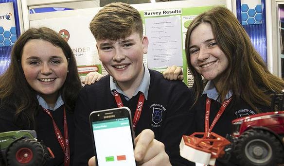 Fourth Year students Sarah McKeogh (16), Adam Fogarty (16) and Elise McWey (15) showcased their Farmer Finder app at the competition in the RDS.