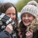 Braced against the cold: Sisters Hannah and Emma Thomas of Templeogue, Dublin, keep out the cold on O'Connell Street PHOTO: COLIN O'RIORDAN