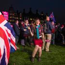 'People's Vote' supporters dance and listen to speeches during a demonstration in Parliament Square on January 15, 2019 in London, England. (Photo by Dan Kitwood/Getty Images)