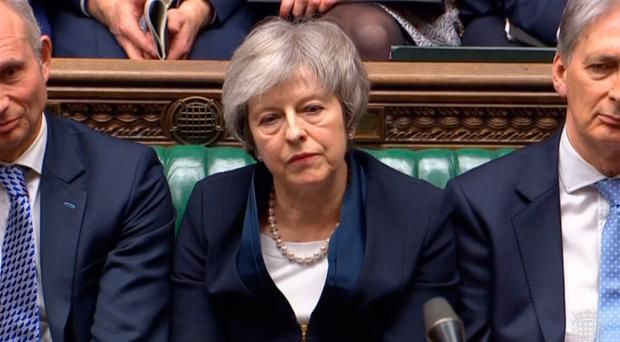 Prime Minister Theresa May listens to Labour leader Jeremy Corbyn speaking after losing a vote on her Brexit deal in the House of Commons, London. PRESS ASSOCIATION Photo. Picture date: Tuesday January 15, 2019. See PA story POLITICS Brexit. Photo credit should read: House of Commons/PA Wire