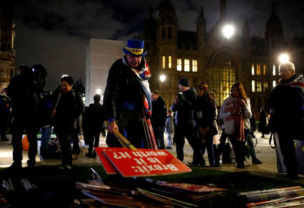 An anti-Brexit protester clears the area after the result was announced on Prime Minister Theresa May's Brexit deal, outside the Houses of Parliament in London, Britain, January 15, 2019. REUTERS/Henry Nicholls