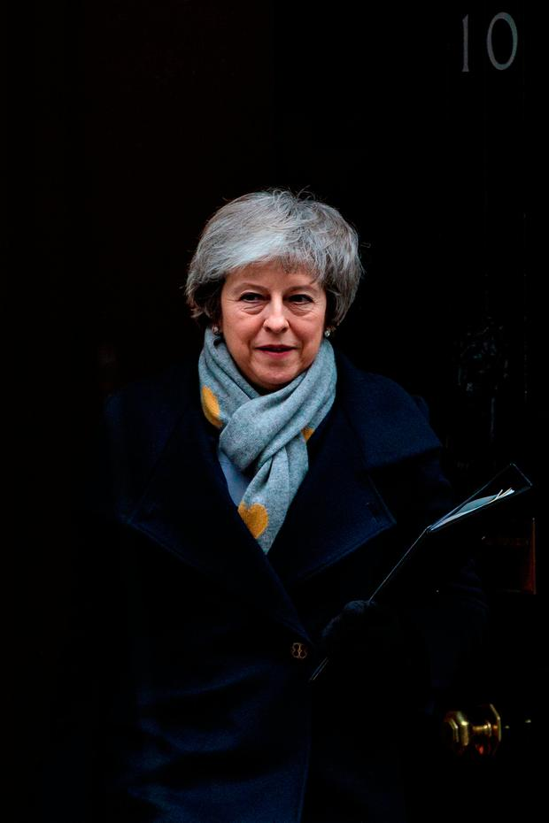 Defeat: British Prime Minister Theresa May leaves Number 10 Downing Street for Parliament yesterday. Picture: Getty