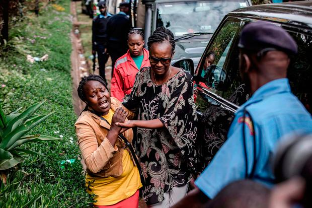 A woman is rescued at the scene of an on going terrorist attack at a hotel complex in Nairobi's Westlands suburb on January 16, 2019.) LUIS TATO/AFP/Getty Images
