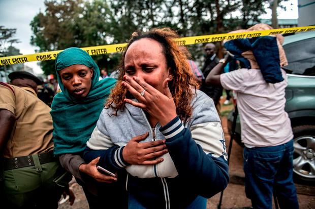 A woman reacts after being rescued from the Dusit Hotel on January 15, 2018 in Nairobi, Kenya. A current security operation is underway after terrorists attacked the hotel. Andrew Renneisen/Getty Images