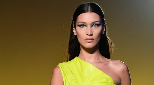 Model Bella Hadid presents a creation for Versace fashion house during the Women's Spring/Summer 2019 fashion shows in Milan, on September 21, 2018. (Photo by Miguel MEDINA / AFP)