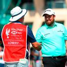 ABU DHABI, UNITED ARAB EMIRATES - JANUARY 16: Shane Lowry of Ireland and caddie Brian