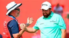 "Shane Lowry (right) is congratulated by his caddie Brian ""Bo"" Martin atthe Abu Dhabi HSBC Golf Championship. Photo: Ross Kinnaird/Getty Images"