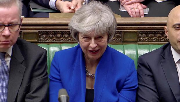 British Prime Minister Theresa May reacts during a confidence vote debate after Parliament rejected her Brexit deal. Photo: Reuters