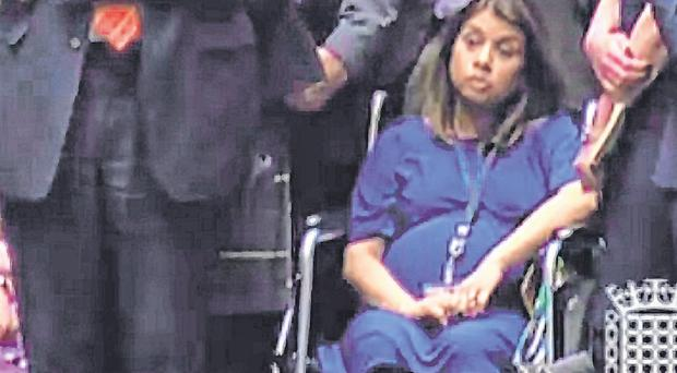 Determined: Labour MP Tulip Siddiq attended parliament in a wheelchair for the vote. Photo: Getty Images