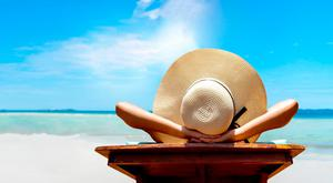 Relaxing on a beach. How can you save money on holidays? PA Photo/thinkstockphotos.