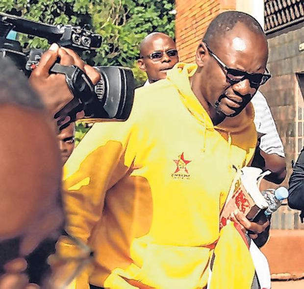 Evan Mawarire speaks to reporters outside the court. Photo: Philimon Bulawayo