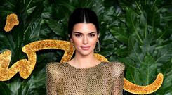 Kendall Jenner has opened up on her 'debilitating' struggle with acne (Ian West/PA)