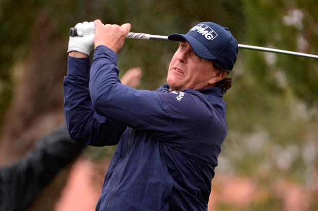 Phil Mickelson plays his shot from the fifth tee during the first round of the Desert Classic golf tournament at La Quinta Country Club